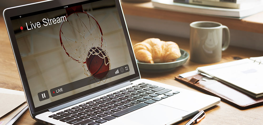 A live stream of a basketball game on a laptop